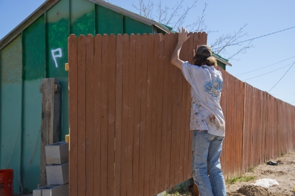 Krista Richardson repairs the fence around her home in a neighborhood that has seen a dramatic rise in poverty near Nellis and Las Vegas boulevards on Thursday, Feb. 25, 2016. Daniel Clark/Las Veg ...