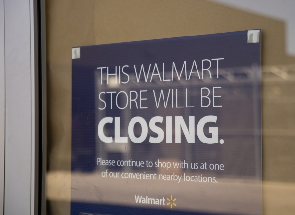 A sign outside a closed Wal-Mart on the corner of Nellis and Las Vegas boulevards directs customers to other locations on Thursday, Feb. 25, 2016. The neighborhood it served has seen a dramatic ri ...