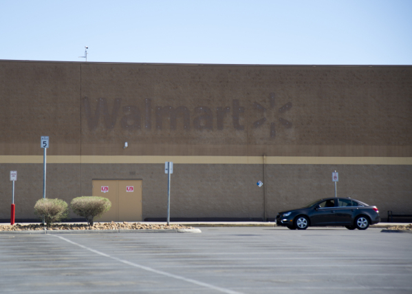 A car drives through the empty parking lot of a closed Wal-Mart on the corner of Nellis and Las Vegas boulevards on Thursday, Feb. 25, 2016. The neighborhood it served has seen a dramatic rise in  ...