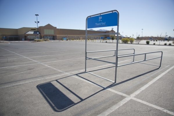 A cart corral remains empty in the parking lot of a closed Wal-Mart on the corner of Nellis and Las Vegas boulevards on Thursday, Feb. 25, 2016. The neighborhood it served has seen a dramatic rise ...