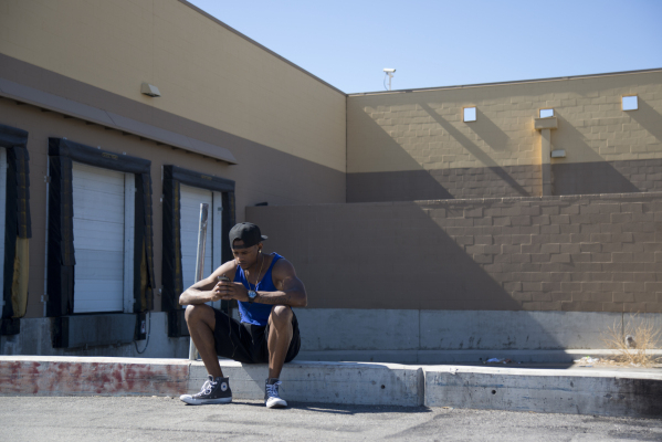 Dominic Reynolds sits outside a closed Wal-Mart in his neighborhood on the corner of Nellis and Las Vegas boulevards on Thursday, Feb. 25, 2016. The neighborhood that relied on the Wal-Mart is sev ...
