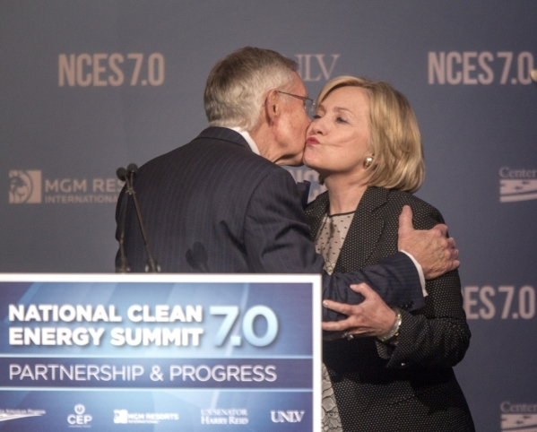 Then-Senate Majority Leader Harry Reid, left, and Hillary Clinton embrace during National Clean Energy Summit 7.0: Partnership & Progress on Sept. 4, 2014, at Mandalay Bay hotel-casino in Las  ...