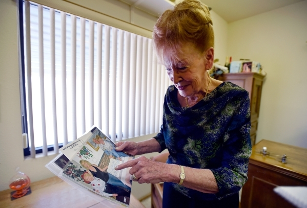 Town founder Nancy Kidwell looks over some photographs in her office at the Cal-Nev-Ari Casino on Thursday, Feb. 25, 2016, in Cal-Nev-Ari. Kidwell together with her late husband, Slim Kidwell acqu ...