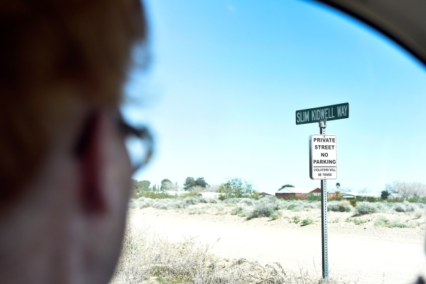 Town founder Nancy Kidwell drives by Slim Kidwell Way, a street named for her late husband Thursday, Feb. 25, 2016, in Cal-Nev-Ari. The two Kidwells acquired 640 acres of land under the federal Pi ...