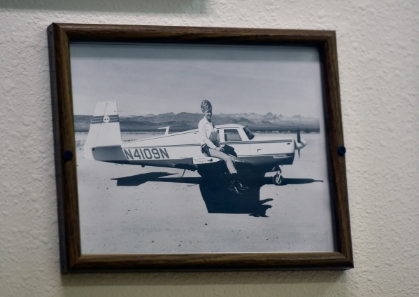 Town founder Nancy Kidwell is seen sitting on the wing of a single engine plane as it is displayed in her office at the Cal-Nev-Ari Casino Thursday, Feb. 25, 2016, in Cal-Nev-Ari. Kidwell, togethe ...