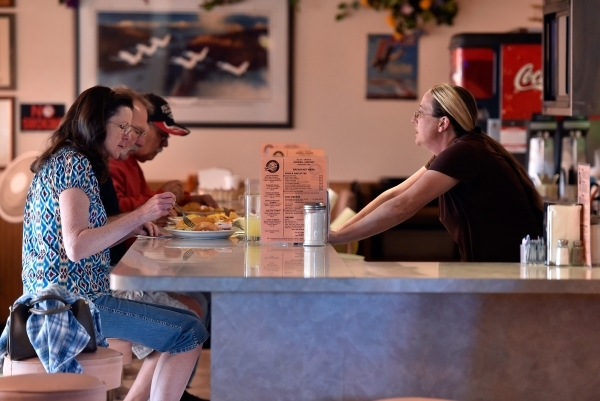 Waitress Jennifer Schumacher, right, tends to her customers at the Cal-Nev-Ari restaurant Thursday, Feb. 25, 2016, in Cal-Nev-Ari. Schumacher has been working for Nancy Kidwell off and on for the  ...