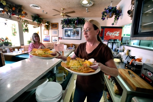 Waitress Jennifer Schumacher delivers two lunch specials at the Cal-Nev-Ari restaurant on Thursday, Feb. 25, 2016, in Cal-Nev-Ari. Schumacher has been working for Nancy Kidwell off and on for the  ...