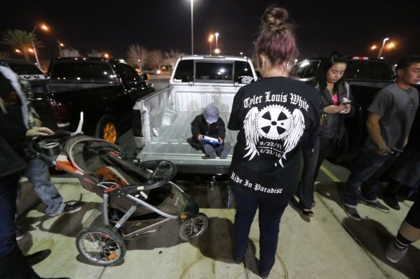 A friend of Tyler Louis White, who was fatally shot Tuesday, wears a handmade memorial shirt at a candlelight vigil at Desert Breeze Park in Las Vegas on Wednesday, Feb. 24, 2016. Rachel Crosby/La ...