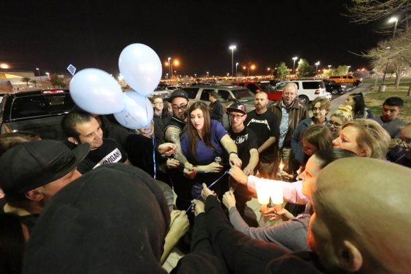 Friends and family release balloons to memorialize Tyler Louis White, who was fatally shot Tuesday, during a candlelight vigil at Desert Breeze Park in Las Vegas on Wednesday, Feb. 24, 2016. Rache ...