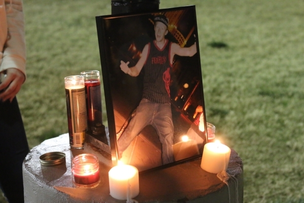 Candles surrounds a photo of Tyler Louis White, who was fatally shot Tuesday, during a candlelight vigil at Desert Breeze Park in Las Vegas on Wednesday, Feb. 24, 2016. Rachel Crosby/Las Vegas Rev ...