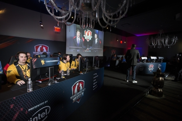 Players get ready to compete in the World of Tanks game during the Wargaming League North America World finals tournament at Downtown Grand Las Vegas casino-hotel on Saturday, Feb. 27, 2016, in La ...