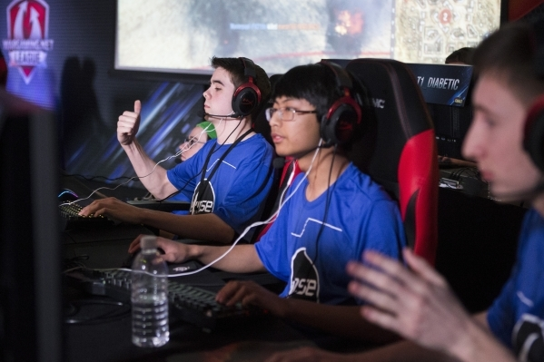 Ian Taylor, left, with team Eclipse, reacts while competing in the World of Tanks game during the Wargaming League North America World finals tournament at Downtown Grand Las Vegas casino-hotel on ...