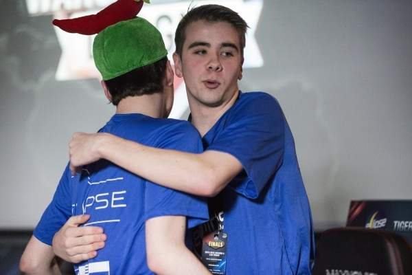 Austin Shatto, left, and Ian Taylor, with team Eclipse, celebrate after their semifinal win in the World of Tanks game during the Wargaming League North America World finals tournament at Downtown ...