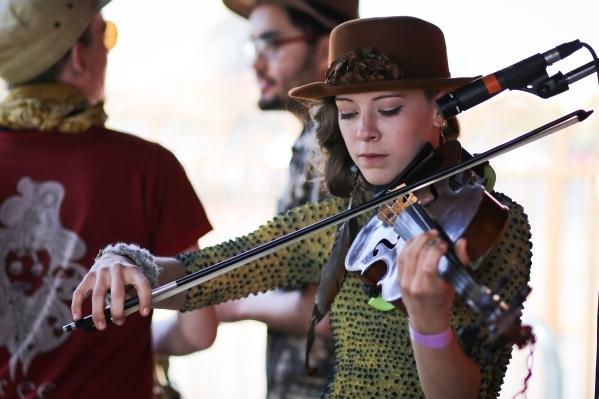 Sarah Zimmermann plays a viola during the Southwest Tea Fest at the Downtown 3rd Farmer's Market at in Las Vegas on Saturday, Feb. 27, 2016. Brett Le Blanc/Las Vegas Review-Journal Follow @b ...