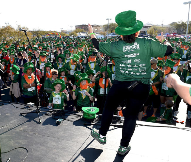 Kathleen Ruddy President of St. Baldrick's Foundation for Childhood Cancer Research and her dancing leprecauhn attempt to teach the hundreds of runners who came out for their 5k run an Irish ...