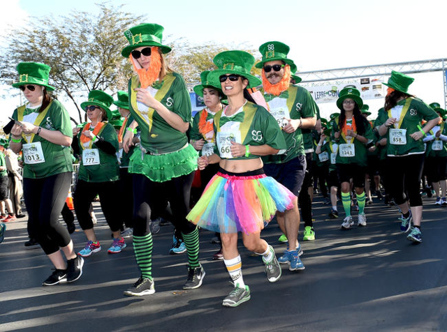 St. Baldrick's Foundation for Childhood Cancer Research 5k Run leaves the starting line as they attempt to break the record for the largest gathering of leprechauns at Town Square in Las Veg ...
