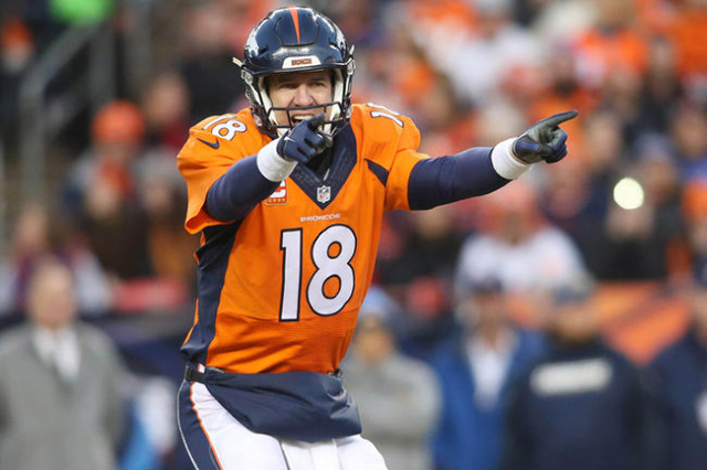 Jan 3, 2016; Denver, CO, USA; Denver Broncos quarterback Peyton Manning (18) signals during the second half against the San Diego Chargers at Sports Authority Field at Mile High. The Broncos won 2 ...
