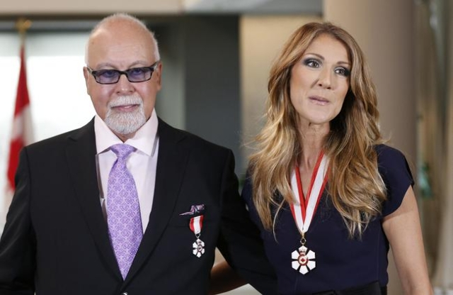 Canadian singer Celine Dion and her husband Rene Angelil pose after receiving the Order of Canada from Canada's Governor General David Johnston at the Citadelle in Quebec City, in this July  ...