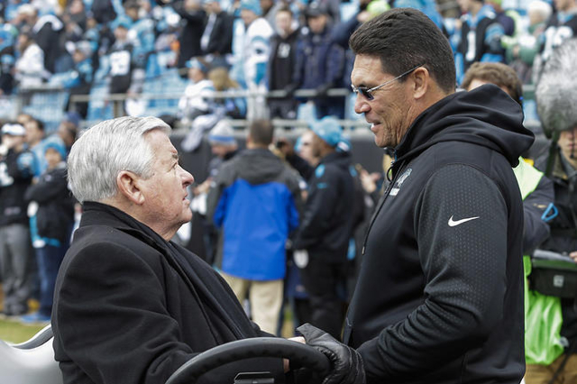 Jan 17, 2016; Charlotte, NC, USA; Carolina Panthers owner Jerry Richardson speaks with head coach Ron Rivera prior to the game between the Seattle Seahawks and Carolina Panthers in a NFC Divisiona ...