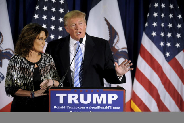 U.S. Republican presidential candidate Donald Trump (R) thanks the crowd after receiving Former Alaska Gov. Sarah Palin's endorsement at a rally at Iowa State University in Ames, Iowa Januar ...