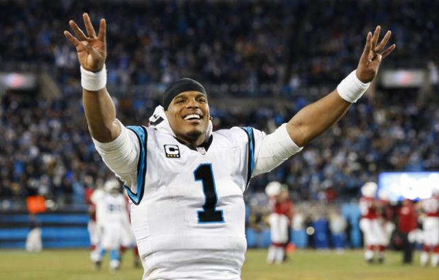 Carolina Panthers quarterback Cam Newton (1) signals the fourth quarter in the NFC Championship football game against the Arizona Cardinals at Bank of America Stadium. Mandatory Credit: Jason Getz ...