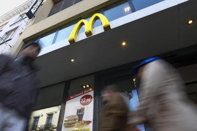 The sign for the U.S. fast food restaurant chain McDonald's is shown outside one of their restaurants in central Brussels, Belgium December 3, 2015. (Reuters/Yves Herman)