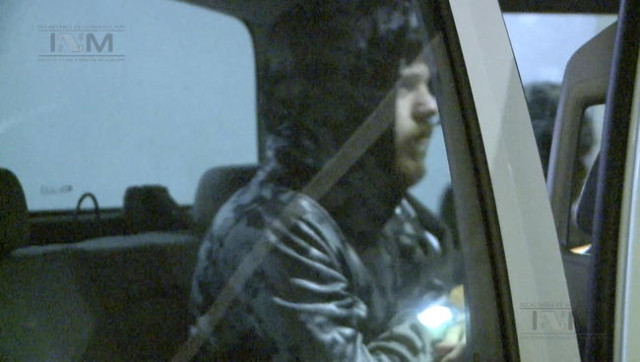 """Ethan Couch, known as the """"affluenza"""" teen after he killed four people in a drunk driving incident in 2013, is seen getting into a Mexican government vehicle to be driven to an airport i ..."""