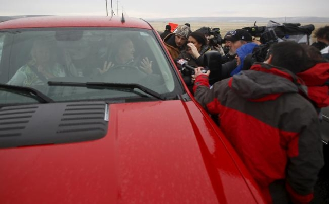 Local ranchers talk to the media after passing through a checkpoint on Highway 205 at the Malheur National Wildlife Refuge outside Burns, Oregon January 28, 2016. U.S. authorities tightened securi ...