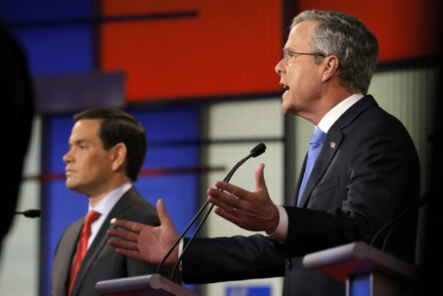 Republican U.S. presidential candidate Jeb Bush (R) speaks as rival and Senator Marco Rubio listens during the debate held by Fox News for the top 2016 U.S. Republican presidential candidates in D ...