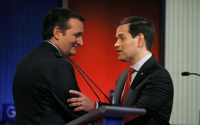 Republican U.S. presidential candidates and U.S. Senators Ted Cruz (L) and Marco Rubio shake hands and talk at the end of the debate held by Fox News for the top 2016 U.S. Republican presidential  ...