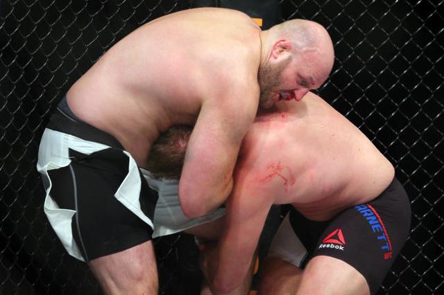 Jan 30, 2016; Newark, NJ, USA; Josh Barnett (black trunks) fights Ben Rothwell (white trunks) during UFC on Fox 18 at Prudential Center. Mandatory Credit: Brad Penner-USA TODAY Sports