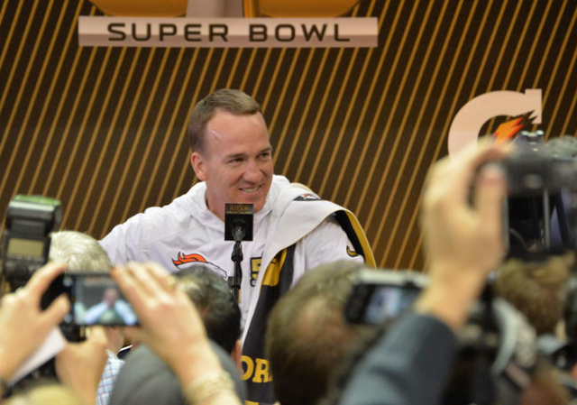 Feb 1, 2016; San Jose, CA, USA; Denver Broncos quarterback Peyton Manning (18) addresses members of the media during Super Bowl 50 Opening Night media day at SAP Center. Mandatory Credit: Kirby Le ...