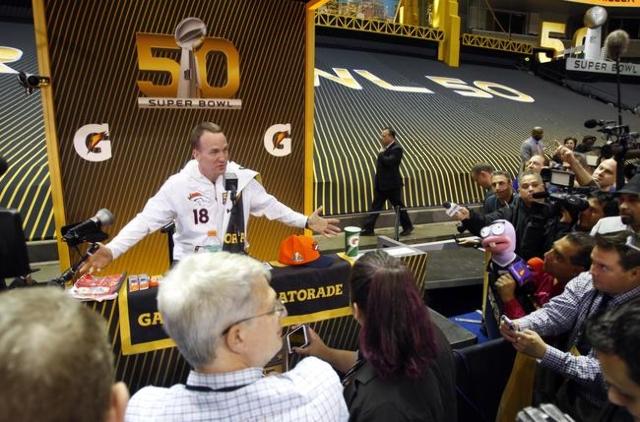 Feb 1, 2016; San Jose, CA, USA; Denver Broncos quarterback Peyton Manning (18) is interviewed during Super Bowl 50 Opening Night media day at SAP Center. Mandatory Credit: Jerry Lai-USA TODAY Sports