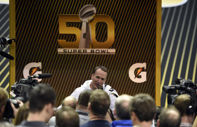 Feb 1, 2016; San Jose, CA, USA; Denver Broncos quarterback Peyton Manning (18) addresses members of the media during Super Bowl 50 Opening Night media day at SAP Center. Mandatory Credit: Kyle Ter ...