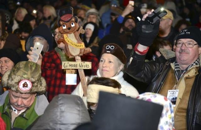 Sharon Adams of Philadelphia cheers for six more weeks of winter prior to Phil's annual weather prediction on Gobbler's Knob on the 130th Groundhog Day in Punxsutawney, Pennsylvania Fe ...