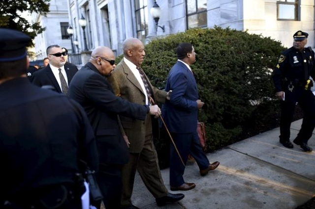 Actor and comedian Bill Cosby (3rd R) arrives for a preliminary hearing on sexual assault charges at the Montgomery County Courthouse in Norristown, Pennsylvania February 2, 2016.  REUTERS/Mark Makela