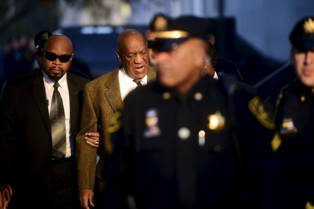 Actor and comedian Bill Cosby (back, 2nd L) arrives for a preliminary hearing on sexual assault charges at the Montgomery County Courthouse in Norristown, Pennsylvania February 2, 2016.  REUTERS/M ...