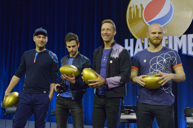 Feb 4, 2016; San Francisco, CA, USA; Recording artists from left Jonny Buckland , Guy Berryman , Chris Martin and Will Champion of Coldplay are presented with gold souvenir footballs during the Su ...