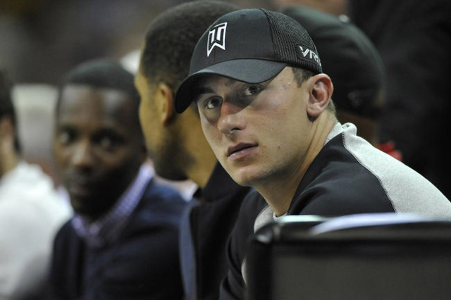 Cleveland Browns quarterback Johnny Manziel watches a Cleveland Cavaliers and Dallas Mavericks basketball game in Cleveland, Ohio, in this file photo taken October 17, 2014.  Manziel's ex-gi ...
