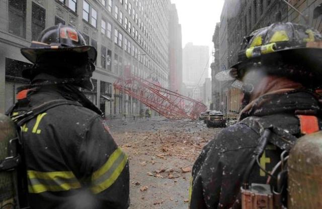 New York City firemen survey a massive construction crane collapse on a street in downtown Manhattan in New York February 5, 2016.  REUTERS/Brendan McDermid
