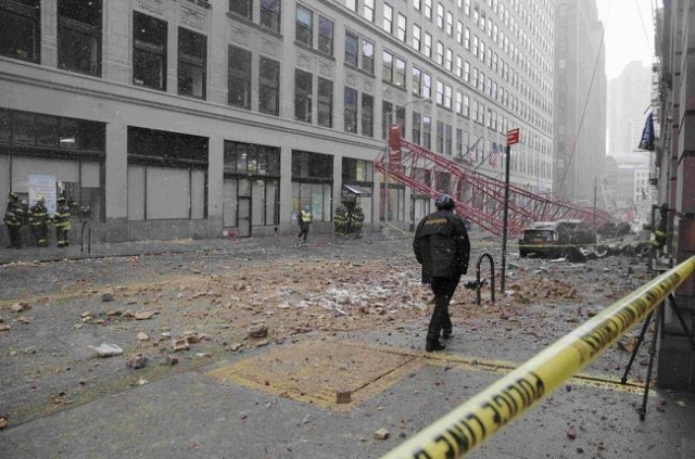 Emergency crews survey a massive construction crane collapse on a street in downtown Manhattan in New York February 5, 2016. The accident killed at least one person and seriously injured two other ...