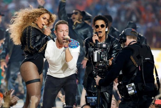 Beyonce (L), Chris Martin (C) and Bruno Mars perform during the half-time show at the NFL's Super Bowl 50 between the Carolina Panthers and the Denver Broncos in Santa Clara, California Febr ...