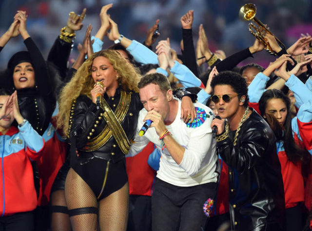 Coldplay singer Chris Martin (center), recording artist Beyonce (left), and recording artist Bruno Mars performs during halftime between the Carolina Panthers and the Denver Broncos in Super Bowl  ...