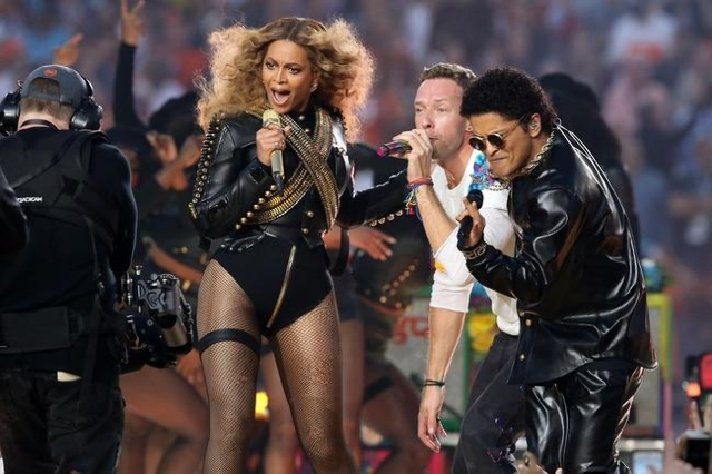 Recording artist Beyonce, Coldplay singer Chris Martin and recording artist Bruno Mars perform during halftime in Super Bowl 50 at Levi's Stadium. Mandatory Credit: Matthew Emmons-USA TODAY  ...