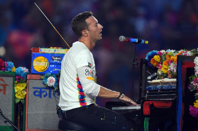 Coldplay singer Chris Martin performs during halftime between the Carolina Panthers and the Denver Broncos in Super Bowl 50 at Levi's Stadium. Mandatory Credit: Robert Deutsch-USA TODAY Sports