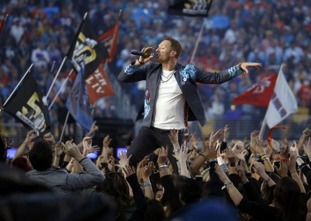 Chris Martin, lead singer of Coldplay, performs during the half-time show at the NFL's Super Bowl 50 between the Carolina Panthers and the Denver Broncos in Santa Clara, California February  ...