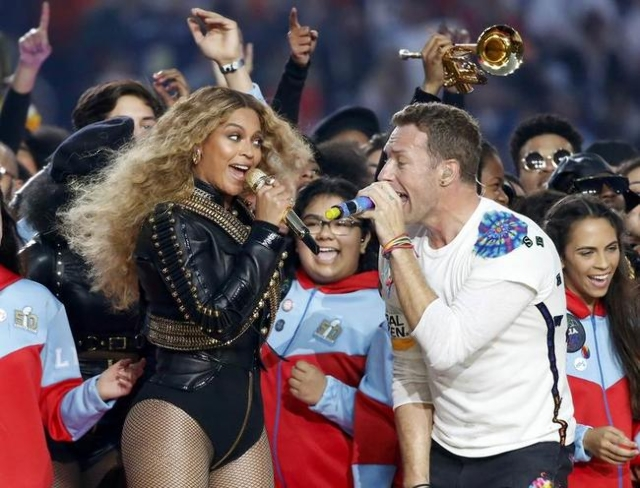 Beyonce and Chris Martin of Coldplay perform during half-time at the NFL's Super Bowl 50 football game between the Carolina Panthers and the Denver Broncos in Santa Clara, California Februar ...