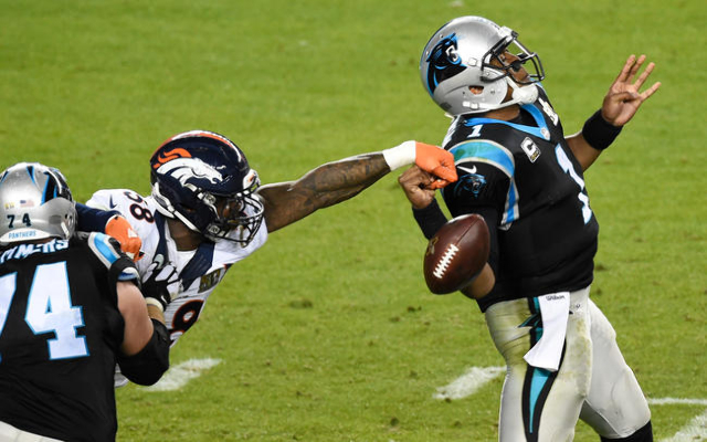 Carolina Panthers quarterback Cam Newton (1) has his pass knocked down by Denver Broncos outside linebacker Von Miller (58) during the fourth quarter in Super Bowl 50 at Levi's Stadium. Mand ...