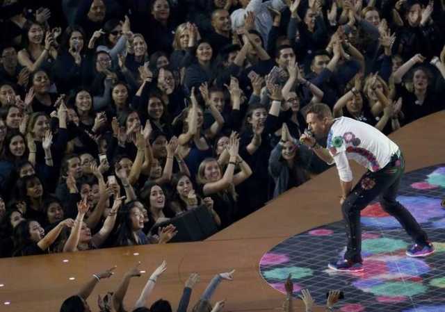 Chris Martin, lead singer of Coldplay, performs with the band during the NFL's Super Bowl 50 football game between the Carolina Panthers and the Denver Broncos in Santa Clara, California Feb ...