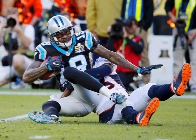 Carolina Panthers' Ted Ginn Jr. (19) is tackled by Denver Broncos' Kayvon Webster on a punt return during the first quarter of the NFL's Super Bowl 50 football game in Santa Clar ...